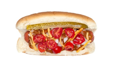 A fully loaded New Your style hotdog with pickles, onions, cheese, chile and tomatoe slices isolated on white photo