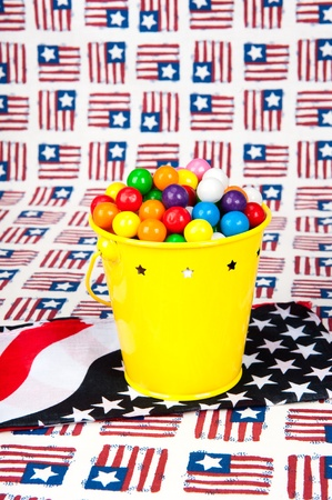 gumballs: A pail of gumballs in a Fourth of July setting