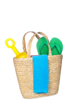 A beachbag carrying a toy shovel, flip flops and a beach towel. Stock Photo - 9780373