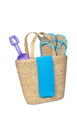 A beachbag carrying a toy shovel, flip flops and a beach towel. Stock Photo - 9780375