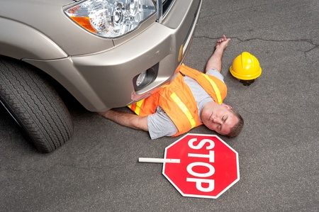 hit man: A road worker is hit by a car.