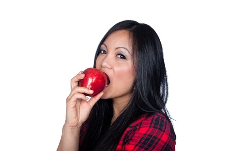 sexy asian woman: A beautiful Asian woman gets ready to eat an apple. Stock Photo