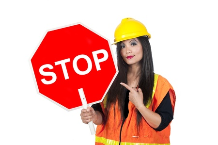 regulating: A sexy Asian woman in construction clothing holds a stop sign.