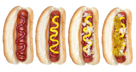 ketchup: A collection of hotdogs with mustard, ketchup, relish and onions. Stock Photo