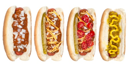 onions: A collection of hotdogs with mustard, ketchup, relish, chili, relish and onions.