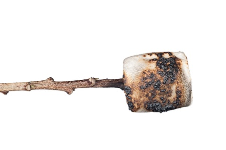 A burned, sweet marshmallow on a stick skewer isolated on white