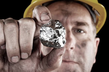 nugget: A silver miner shows off his newly excavated silver nugget.