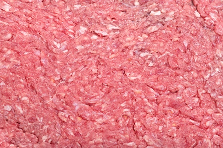 butchered: The surface of raw ground beef showing the fatty tissue.