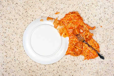 carpet stain: A dropped plate of spaghetti on new carpeting. Stock Photo