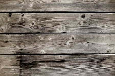 worn: Old, aged wooden slats with a grungy look.