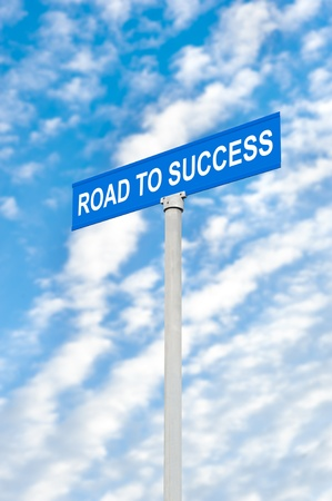 A road to success street sign against a blue, cloudy sky for use as inspirational use for investing or any other success inference