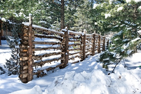 defines: A traditional log fence defines the boundaries of private property.