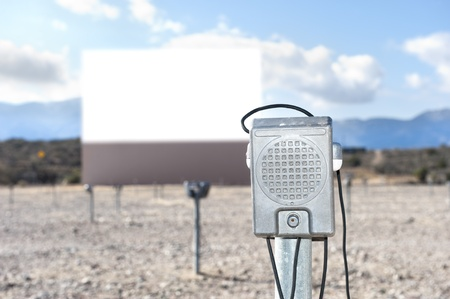 old movies: A vintage drive in theater with a close up of the window-mounted speaker.