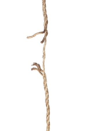 unravel: A frayed rope isolated on a white background Stock Photo