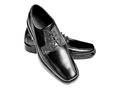 A pair of new leather dress shoes on a white background