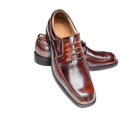 mens: A new pair of brown leather dress shoes on a white background Stock Photo