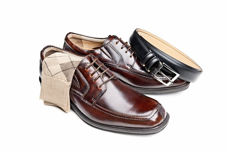 A new pair of brown leather dress shoes with argyle socks and a black belt photo