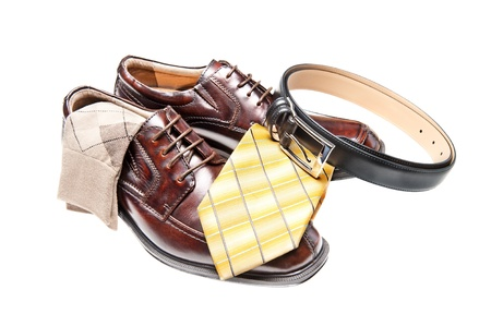 Brown leather dress shoes with argyle socks and a black belt photo