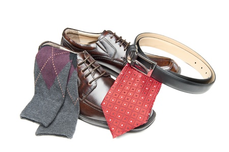 mens shoes: New brown leather shoes with red necktie and Argyle socks on white