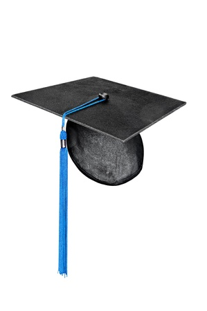 A mortar board graduation cap with blue tassel isolated on white photo
