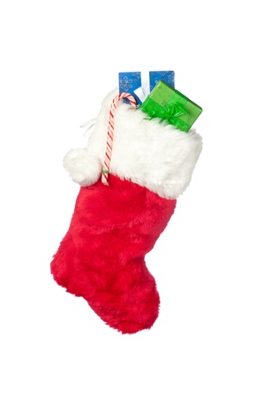stuffer: A Christmas stocking with stocking stuffer presents isolated on white.