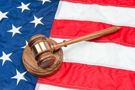 inference: A gavel and sound block on an American flag representing the legal system and any law inference in the USA Stock Photo
