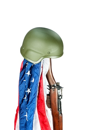 Military helmet on old WWII Enfield rifle with American flag photo