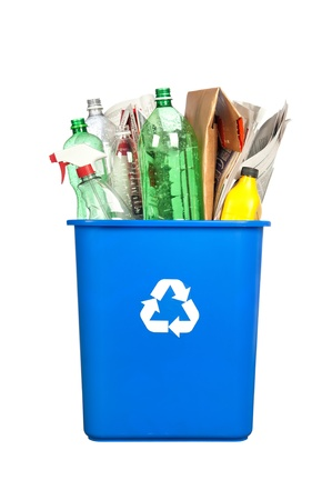 blue bin: A recycling bin with plastic bottles, paper, cardboard and other plastic items isolated on white.