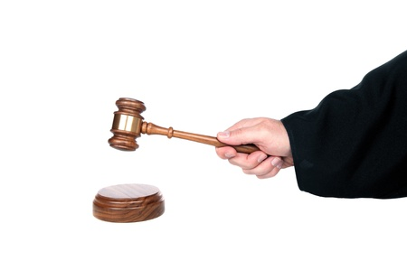 Judge hits a sound block with his gavel   Image is isolated for designer convenience   photo