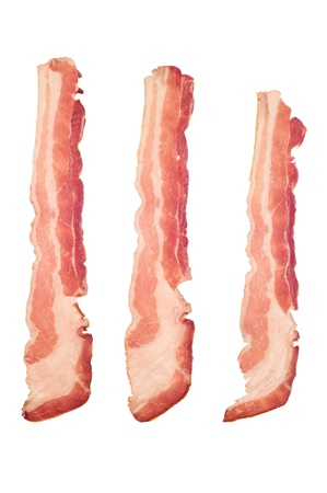 uncooked bacon: Three strips of raw bacon isolated on a white background.  Image is suitable for many cooking and health inferences.