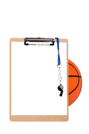 A coachs clipboard with blank sheet of paper, whistle and pencil rests against a basketball and is isolated on white.  Designers can place copy on the blank sheet of paper.