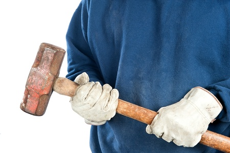 sledge hammer: A man wearing old leather gloves holds  a heavy sledgehammer.  Image is isolated for disigner convenience.