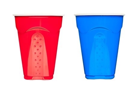 solo: Red and blue plastic, disposable  drinking cups, typically used at picnics and parties, isolated on white.