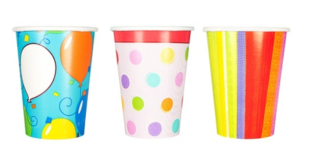 A set of disposable, paper party cups for birthdays and other celebrations and parties.  Isolated on a white background.