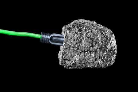 bituminous coal: A conceptual image of an extension cord plugged intop a chunk of bituminous coal isolated on black.