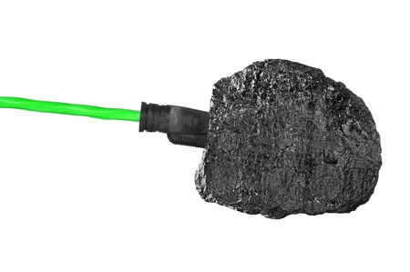 plugged: Chunk of coal with en extension cord plugged into it. Stock Photo