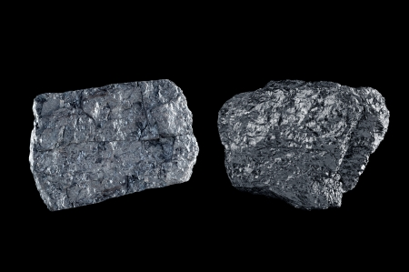 bituminous coal: Two chunks of bituminous coal use to generate power isolated on black.