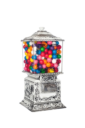 multicolored gumballs: A 1950s retro vintage candy machine isolated on white.
