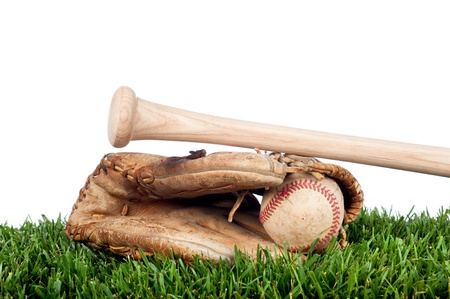 Baseball glove, ball, and bat laying on grass with a white background for placement of copy.