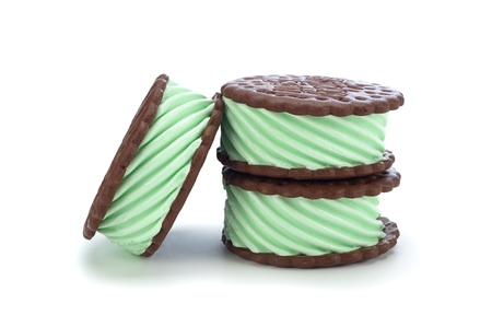 Green mint chocolate ice cream sandwich on a white background