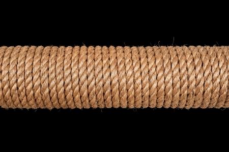 A spool of hemp rope isolated on black photo