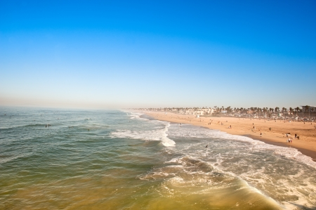 orange county: Huntington Beach, California in the morning shows the tides changing during a sunny weekend.