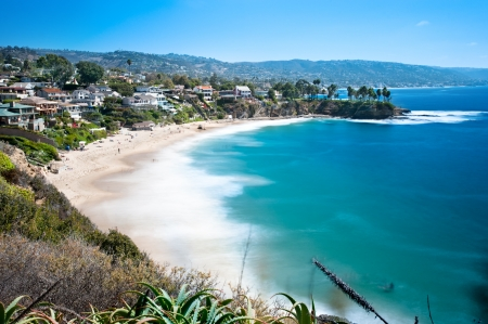 An image of a beautiful cove called Crescent Bay in Laguna Beach, California.  Shot with a slow shutter to capture the water motion on a bright sunny day. Stock Photo