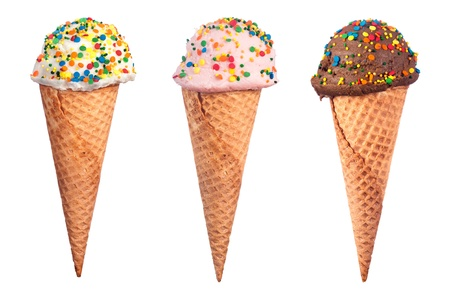 An assortment of waffle cone ice cream with chocolate, strawberry and vanilla ice cream scoops coverd with colorful candy sprinkled. Banco de Imagens
