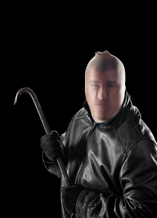 bandits: A criminal wearing pantyhose over his head to hide his identity carries a crowbar to commit a crime.