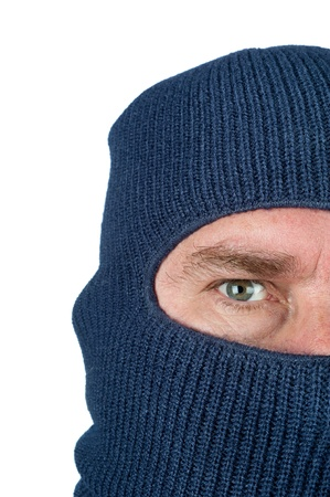 ski mask: A burglar wearing a blue ski mask to hide his identity. Isolated on white for user convenience. Stock Photo