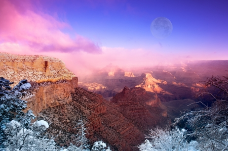 A dramatic winter image of the Grand Canyon shot at the Bright Angel Village overlook at the South Rim in Arizona during December.