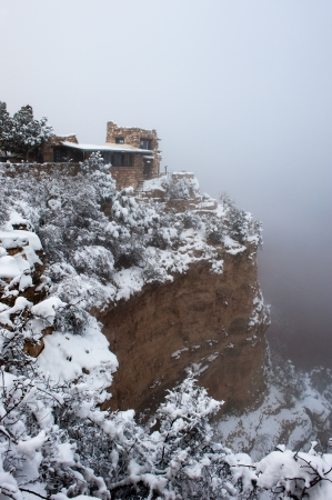 inclement: A cliffside overlook at the Grand Canyon in Arizona during a foggy, cold day. Stock Photo
