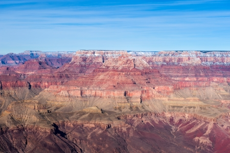A mid day image of the Grand Canyon at the South Rim in Arizona during winter time. photo