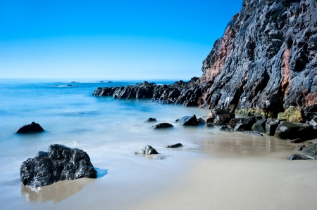 A peaceful image of shoreline scenery in Laguna Beach California.  Image shot to capture the motion of the water. photo